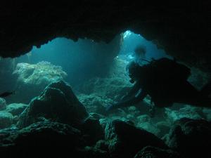 diving a swim through in lanzarote